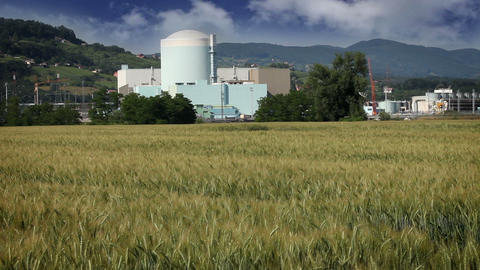Grain Field With Nuclear Station In The Back stock footage