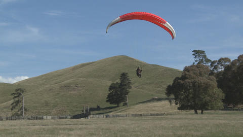 Para Glider Landing In A Field stock footage