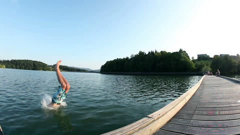 Jumping and wimming in the lake low angle shot Footage