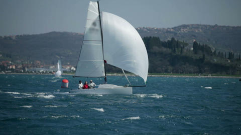 Team Of Sailors On Sailboat Speeding On Sea At Win stock footage