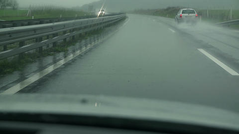 View on a wet highway on a cloudy and misty day Footage