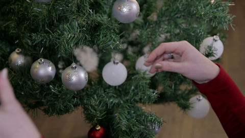 Slide In While Female Adding Ornaments On Christma stock footage