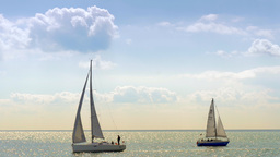 4K Serene Seascape With Yachts Sailing stock footage