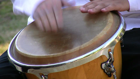 Drumming on conga drum 1 Footage