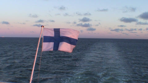 Finnish flag on passenger cruise ship at sunrise, close-up Footage