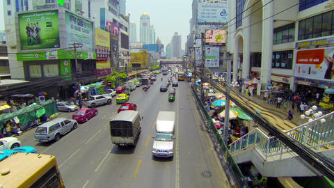 BANGKOK - APR 12: Cars And Bus Drive In A Flow Of stock footage