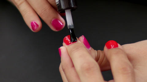 Make Up Making Red Nails Glossy stock footage