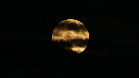 Scary Orange Super Moon with Clouds Footage