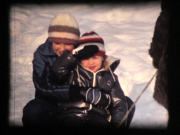 Two girls and mother in winter, snow sled fun Footage