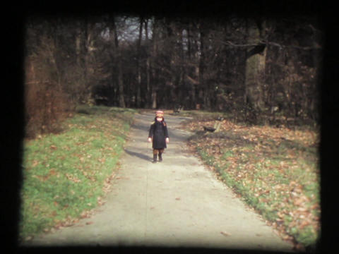 Small Girl Walking Down Park Wood Path stock footage