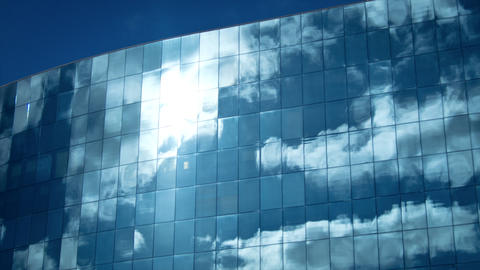 Clouds reflected in office building Footage