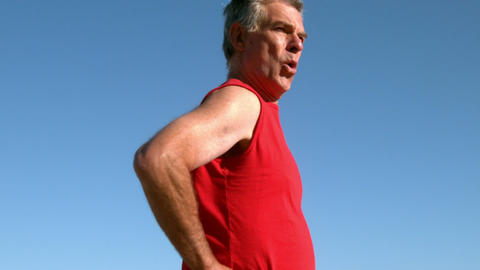 Senior Man Jogging On Sunny Day stock footage