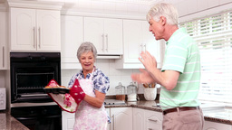 Senior Happy Couple Baking Cookies stock footage