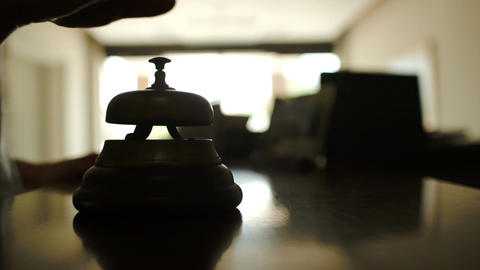 Woman Ringing Reception Bell In Hotel stock footage