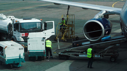 Workers Getting Luggage From Airplane Footage
