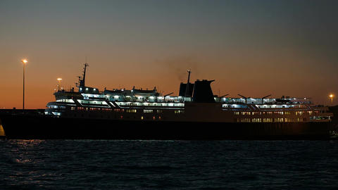 Illuminated Cruise Ship In Late Evening stock footage