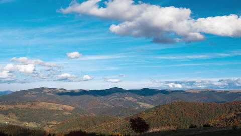 Clouds Over The Forested Mountains. Time Lapse 4K stock footage