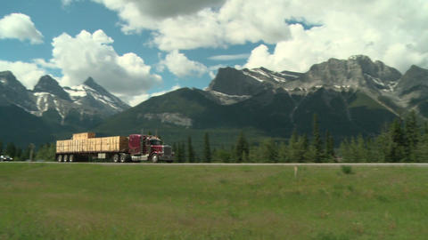 Lumber Transport Truck In The Rocky Mountains stock footage