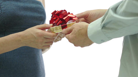 Man Giving Girl Gift Red Bow Behind View stock footage
