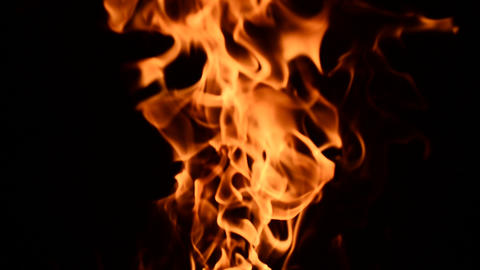 Fire Burning, Close Up View. Low Key Effect. Loop stock footage