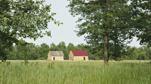 New Wooden Rural Houses Are Built In A Field stock footage