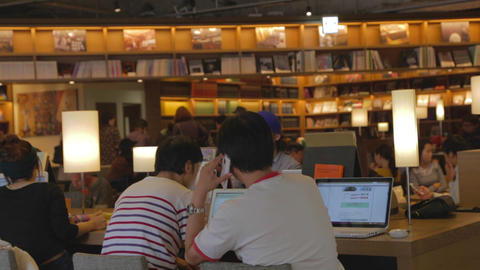 men on cell phone laptop at Starbucks Footage