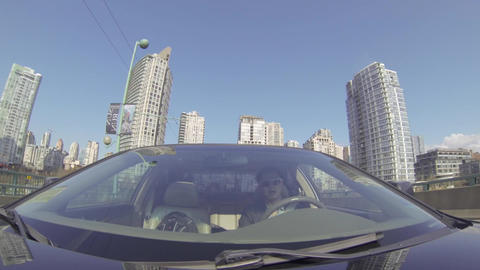 driving tour facing car downtown to city center Footage