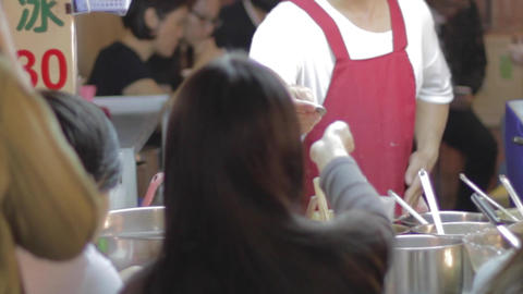 Taiwan Couple Dine At Outdoor Food Stand stock footage