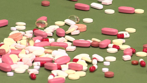 Pills On Green Background stock footage