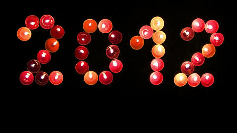2012 Made ​​of Colored Candles On A Black Background stock footage