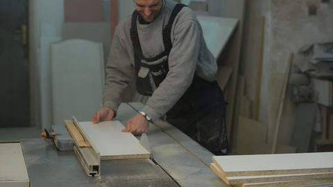 Carpenter Cutting The Wooden Panel With Circular S stock footage