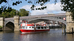 River cruise boat passes under bridge. River Ouse, Footage