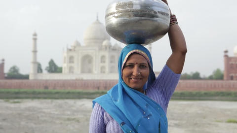 Indian Woman Wearing Sari In Front Of Taj Mahal stock footage
