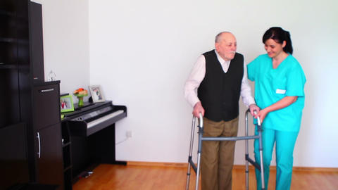 Carer Helping Elderly Senior Man Using Walking Footage