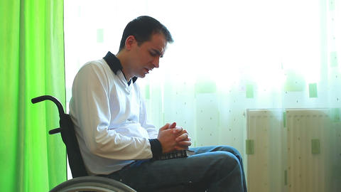 Man In A Wheelchair Praying stock footage