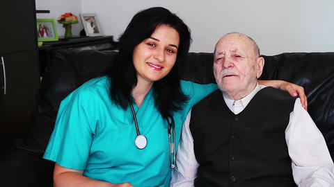 Nurse Giving Care To A Senior Man stock footage