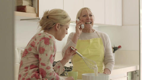 Women In Kitchen At Home, Mother Speaking On The Phone stock footage