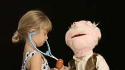 Little Girl Puppet Doctor Care stock footage