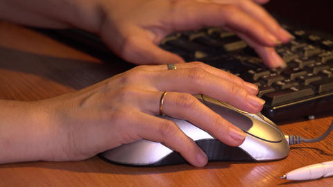 Female Hand On Computer Mouse. 4K stock footage