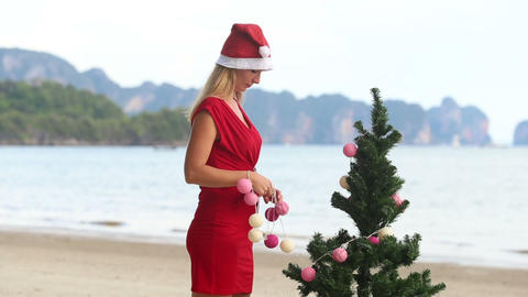 Girl In A Red Dress And A Christmas Cap stock footage