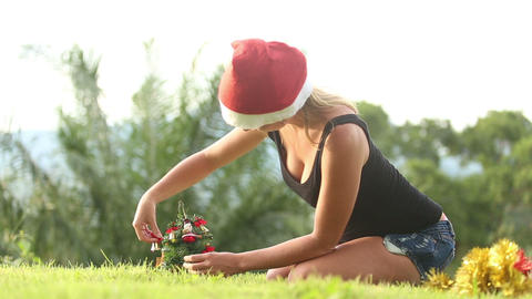 Girl Straightens Ornaments On A Christmas Tree stock footage