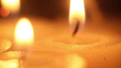 Moving Focus On Burning Candles Close-up stock footage