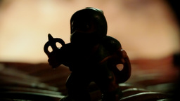 Toy silhouette into fire macro Footage