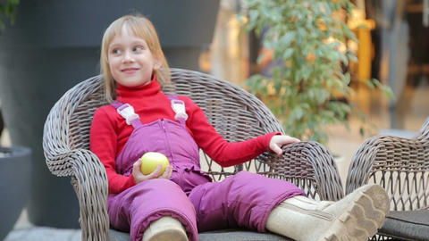 Girl sitting on a chair made of twigs Footage