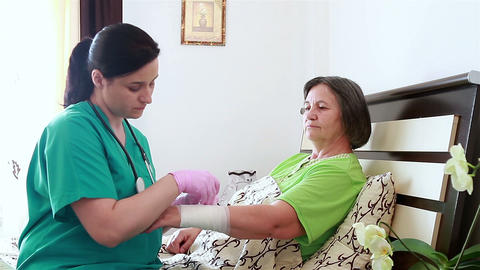 Nurse Bandaging The Wrist Of Senior Woman stock footage