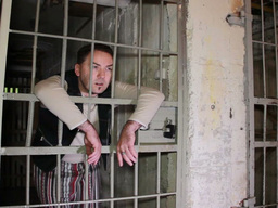 Creepy Looking Prisoner In A Dingy Cell stock footage