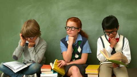 Focused Pupils Sitting In Classroom Reading Books stock footage
