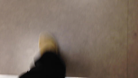 Close-up View Of Man's Foot Walking On Tilt Floor stock footage