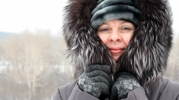 Woman Wrapped In A Fur Collar Because Of Cold stock footage