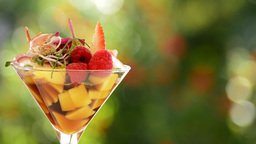 Cocktail Glass With Strawberry And Mango Detail stock footage